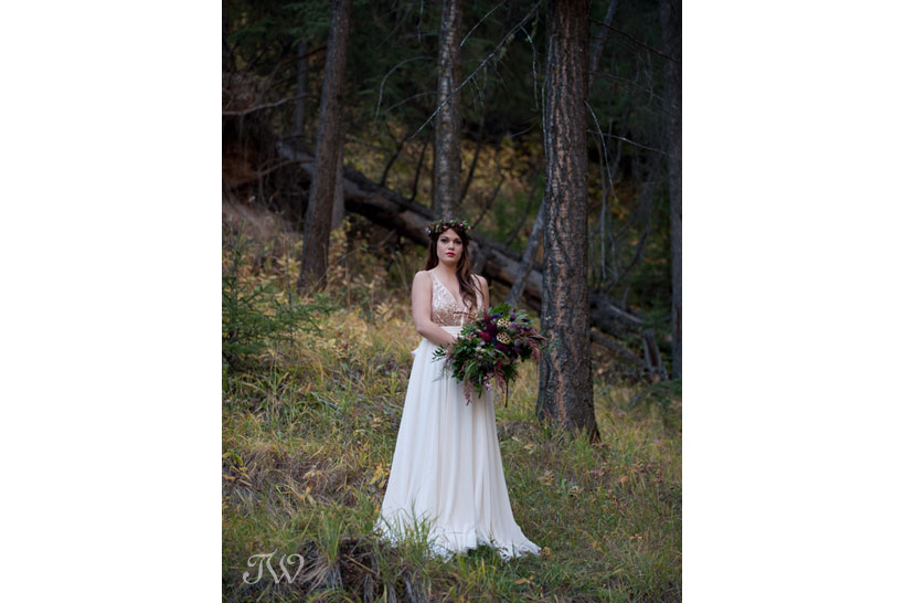 Banff bride poses in the woods captured by Tara Whittaker Photography