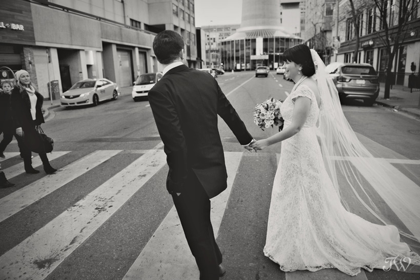 Calgary bride and groom on Stephen Avenue captured by Tara Whittaker Photography