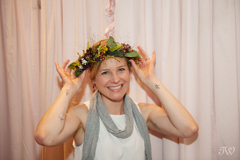 A guest wears her flower crown captured by Tara Whittaker Photography