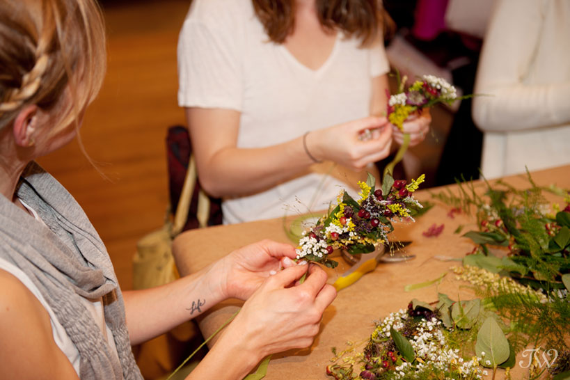 adding flowers to the crown at DIY workshop at Adorn captured by Tara Whittaker Photography