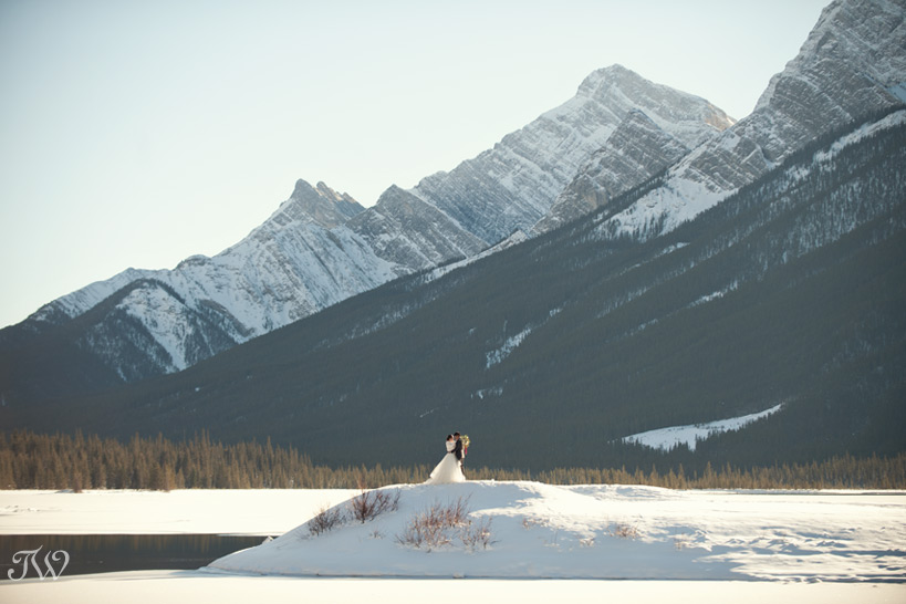 bride and groom at Spray Lakes in the Canadian Rocky Mountains captured by Tara Whittaker Photography