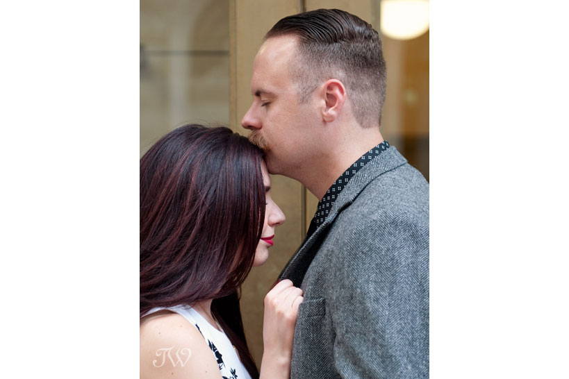 couple pose for engagement photos in downtown Calgary captured by Tara Whittaker Photography