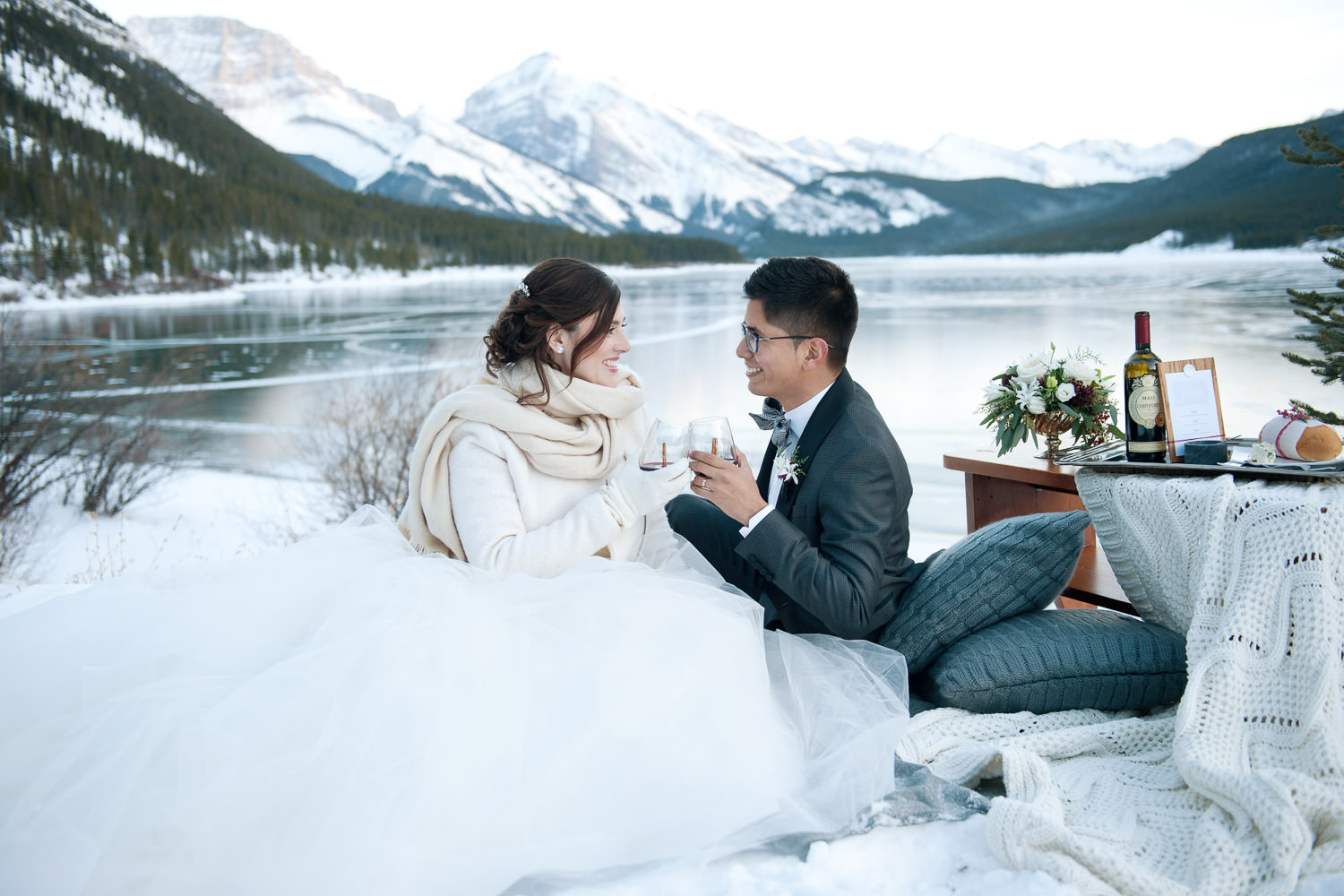 bride and groom toast their vows at Spray Lakes captured by Tara Whittaker Photography