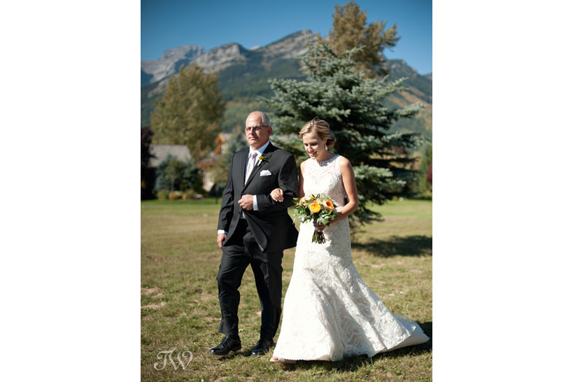 Father walks his daughter down the aisle for her Fernie wedding captured by Tara Whittaker Photography