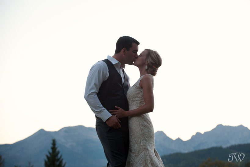 Bride and groom kiss after their Fernie wedding captured by Tara Whittaker Photography