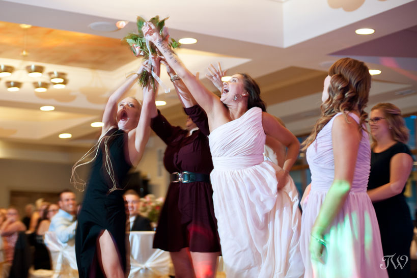 Bouquet toss captured by Blue Devil Golf Club wedding photographer