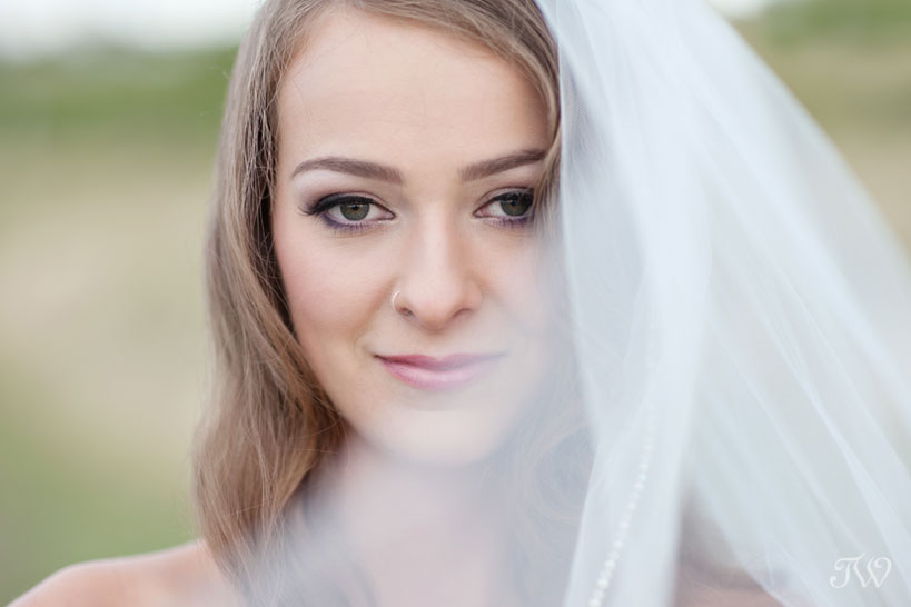bride in a wedding veil captured by Calgary wedding photographer Tara Whittaker