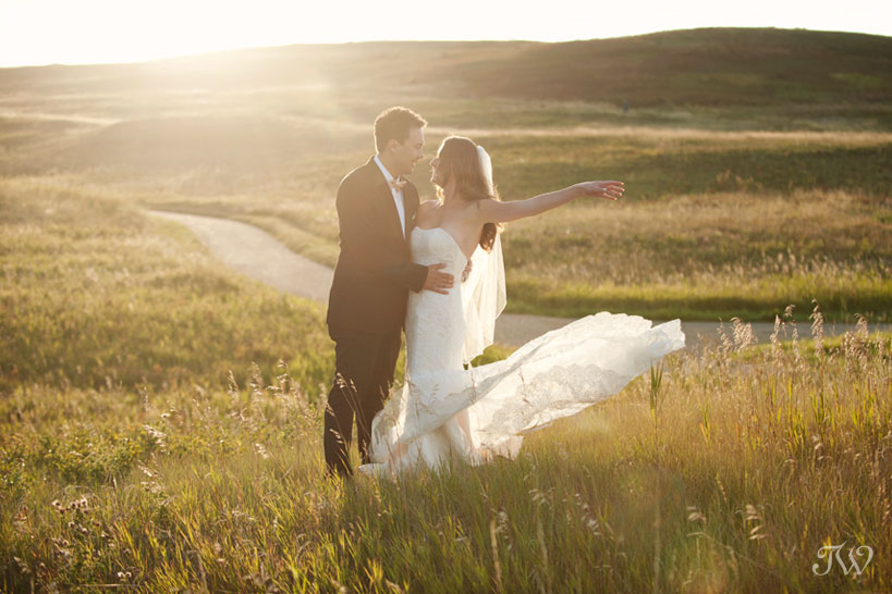 bride and groom in Nose Hill Park captured by Tara Whittaker Photography
