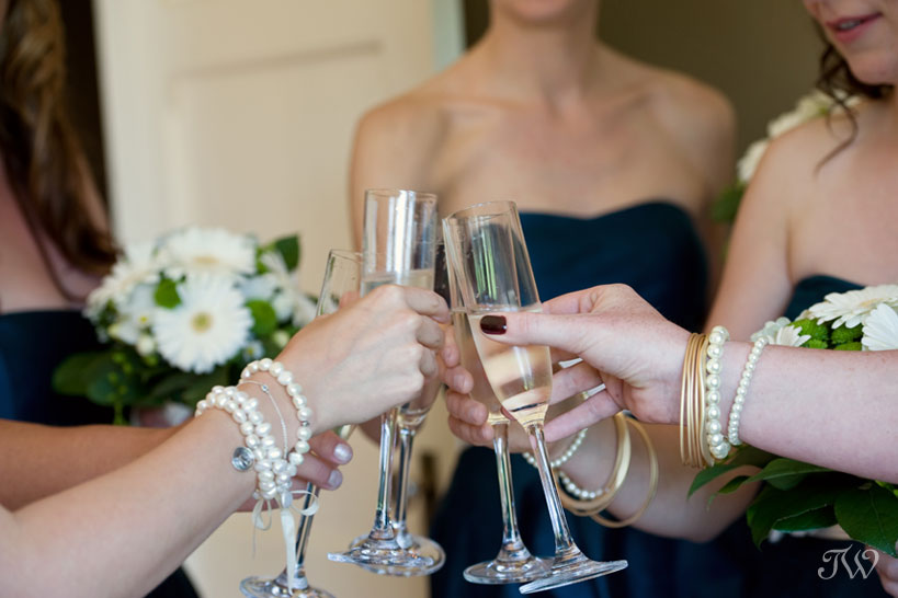 champagne toast in the Tsuu T'ina bride's room at Bow Valley Ranche captured by Tara Whittaker Photography