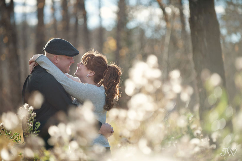 couple embrace during their engagement session captured by Tara Whittaker Photography