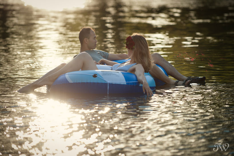 summer engagement session on the elbow river captured by Tara Whittaker Photography