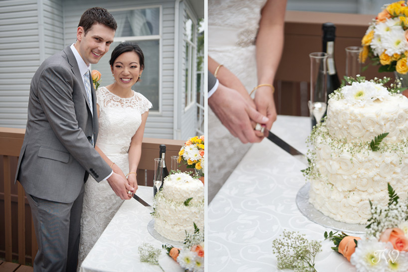 cutting the wedding cake captured by Tara Whittaker Photography
