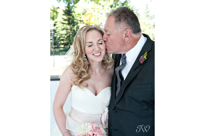 bride with her father at Heritage Park captured by Tara Whittaker Photography