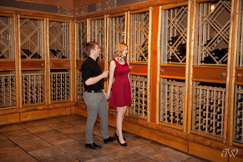 couple tour the wine cellar at Buffalo Mountain Lodge captured by Tara Whittaker Photography