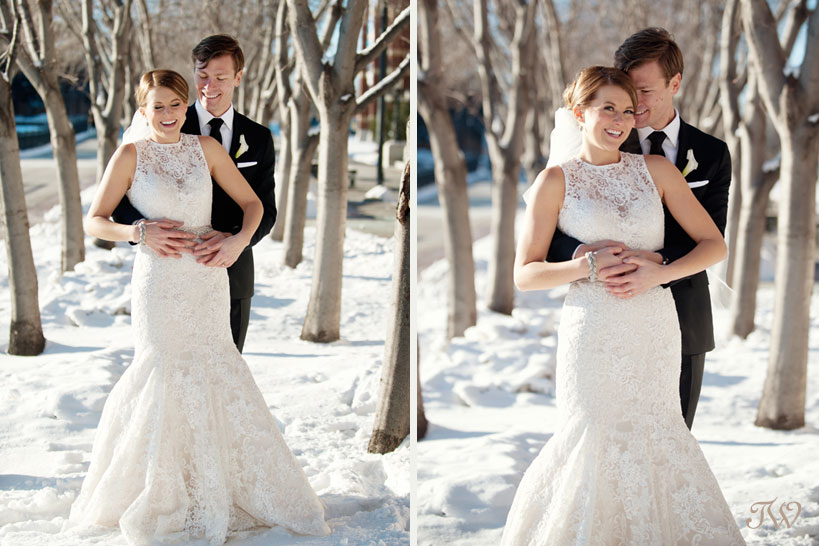 bride and groom pose for winter wedding photos at SAIT captured by Tara Whittaker Photography