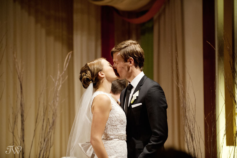 First kiss captured by Calgary wedding photographer Tara Whittaker