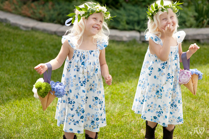 flower girls carrying ice cream cone flower bouquets