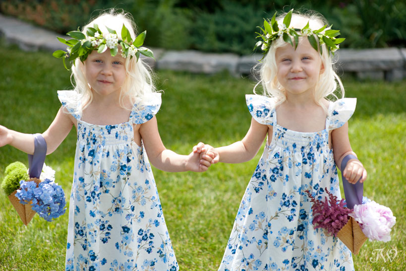 flower girls walking down the aisle with ice cream cone bouquets