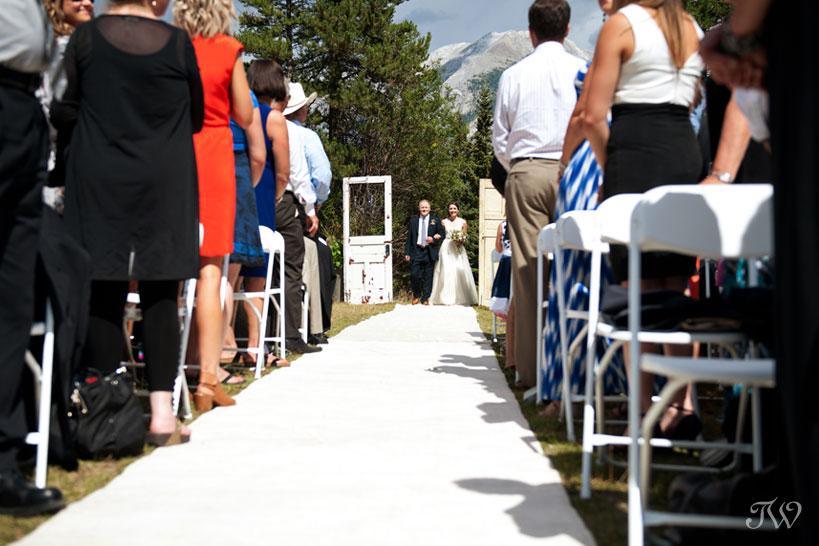 father walks bride down the aisle captured by Calgary wedding photographer Tara Whittaker