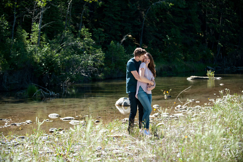 engagement pictures on a river in Elbow Valley captured by Tara Whittaker Photography