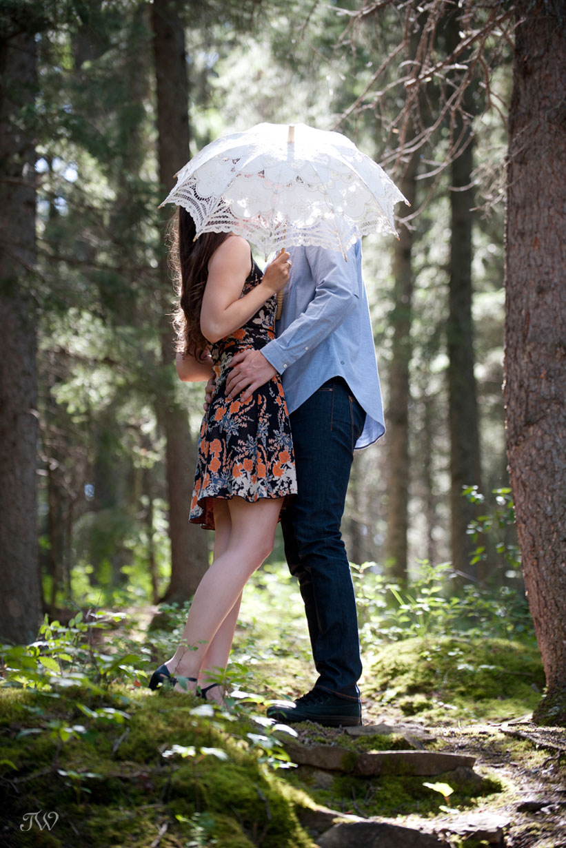 bride and groom kiss under an umbrella during Elbow Valley engagement session