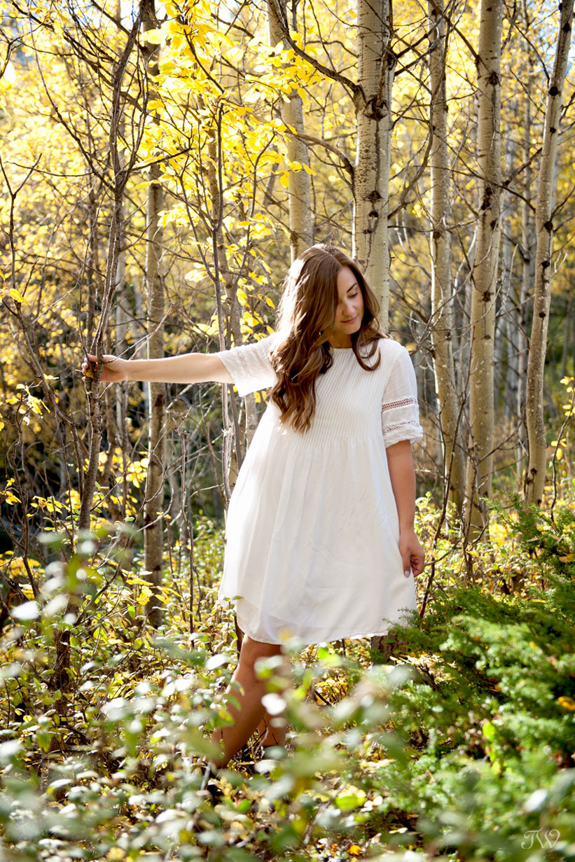 fall bride amongst the autumn leaves captured by Calgary wedding photographer Tara Whittaker