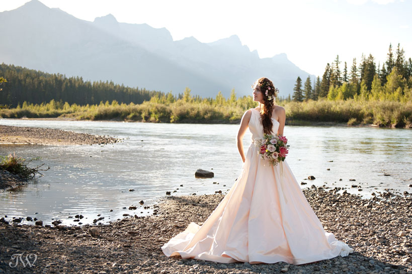 Rocky Mountain bride on the Bow River in Canmore captured by Tara Whittaker Photography