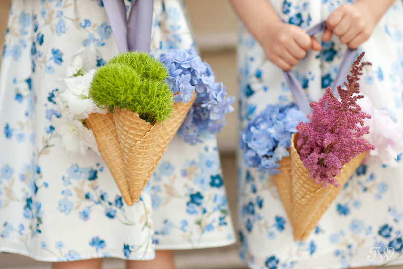 flower girls carry ice cream cone bouquets captured by Tara Whittaker Photography