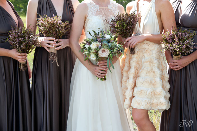 bride and bridesmaids with bouquets at a Canmore wedding captured by Tara Whittaker Photography