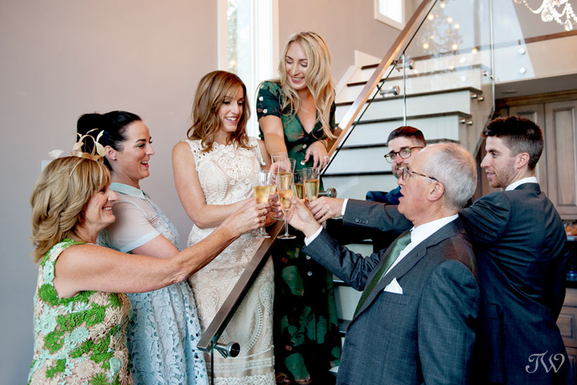bride toasts with her family before her Charbar wedding captured by Tara Whittaker Photography