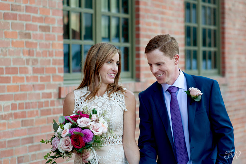 Bride and groom at the Simmons building before their Charbar Calgary wedding