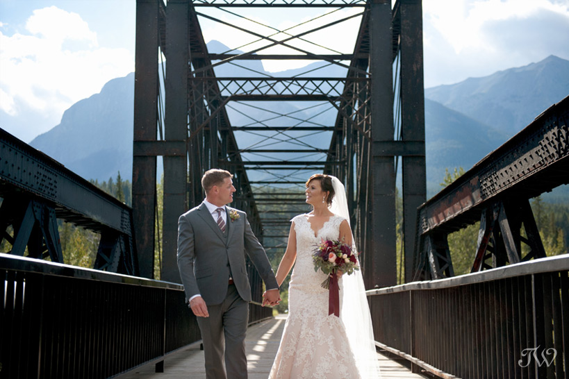 couple on the railway bridge in Canmore captured by Tara Whittaker Photography