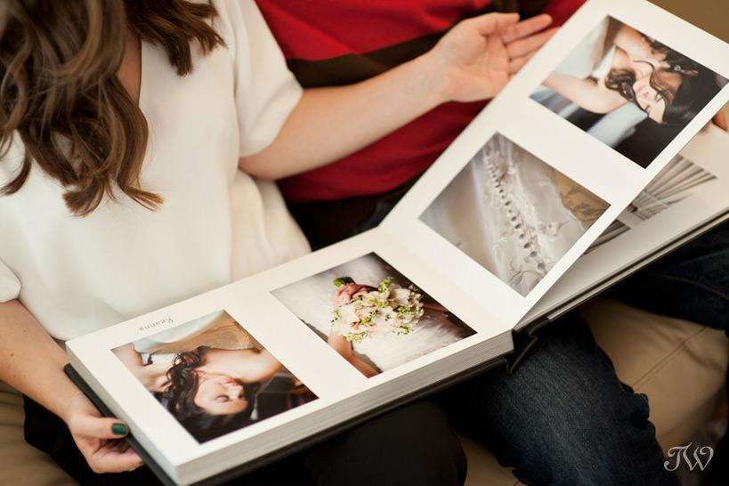 viewing an album and choosing a wedding photographer Tara Whittaker