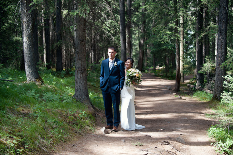 first look during mountain elopement packages with Calgary wedding photographer Tara Whittaker