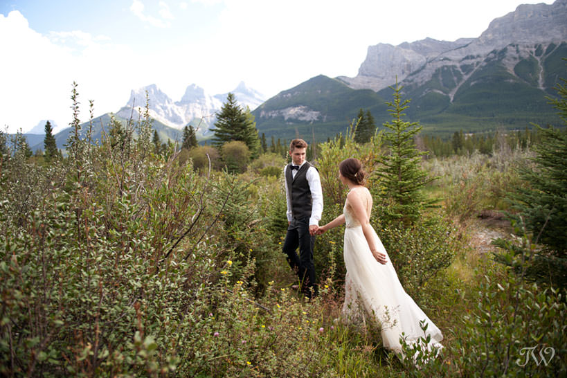 Bride and Groom with The Three Sisters Canmore wedding captured by Tara Whittaker Photography