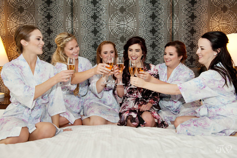 bridal party celebrates before a Lake House wedding captured by Calgary wedding photographer Tara Whittaker
