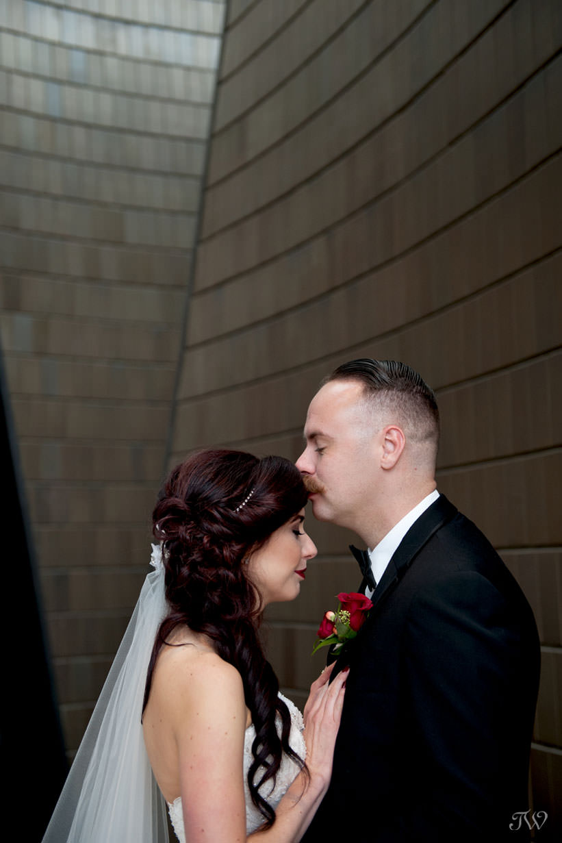 bride and groom at the National Music Centre captured by Calgary wedding photographer Tara Whittaker