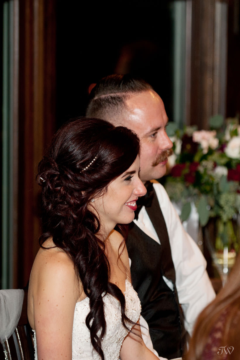 bride and groom at their Lake House wedding reception captured by Tara Whittaker Photography