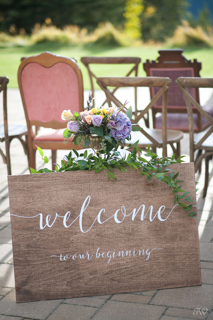 welcome site at a Silvertip wedding captured by Calgary wedding photographer Tara Whittaker