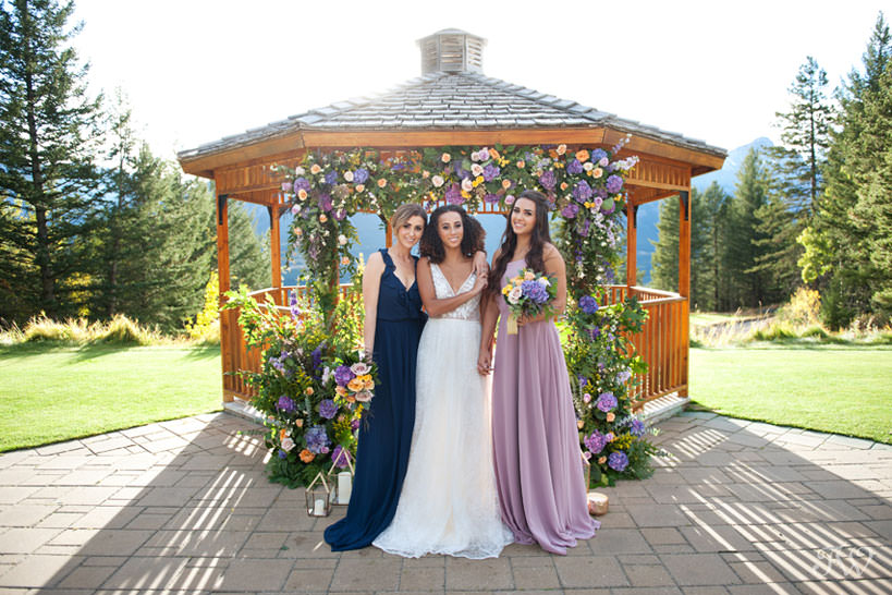 bridal party at the Silvertip wedding gazebo captured by Calgary wedding photographer Tara Whittaker