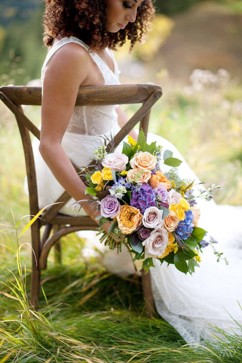 fall bride with her bouquet at a Silvertip wedding captured by Calgary wedding photographer Tara Whittaker