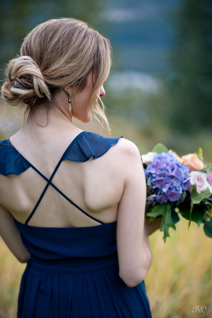 fall bridesmaid in Joanne August at a Silvertip wedding captured by Calgary wedding photographer Tara Whittaker