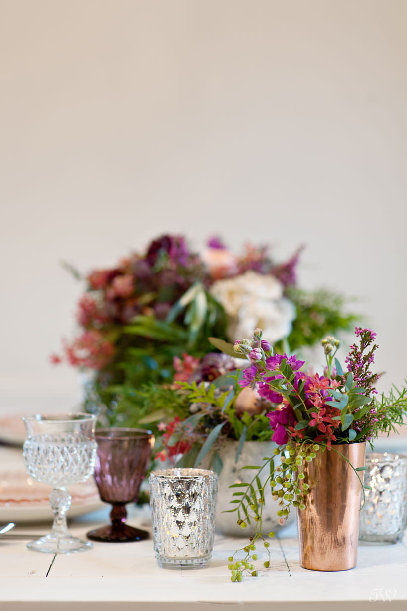 tabletop details in berry tones winter wedding inspiration captured by Calgary wedding photographer Tara Whittaker