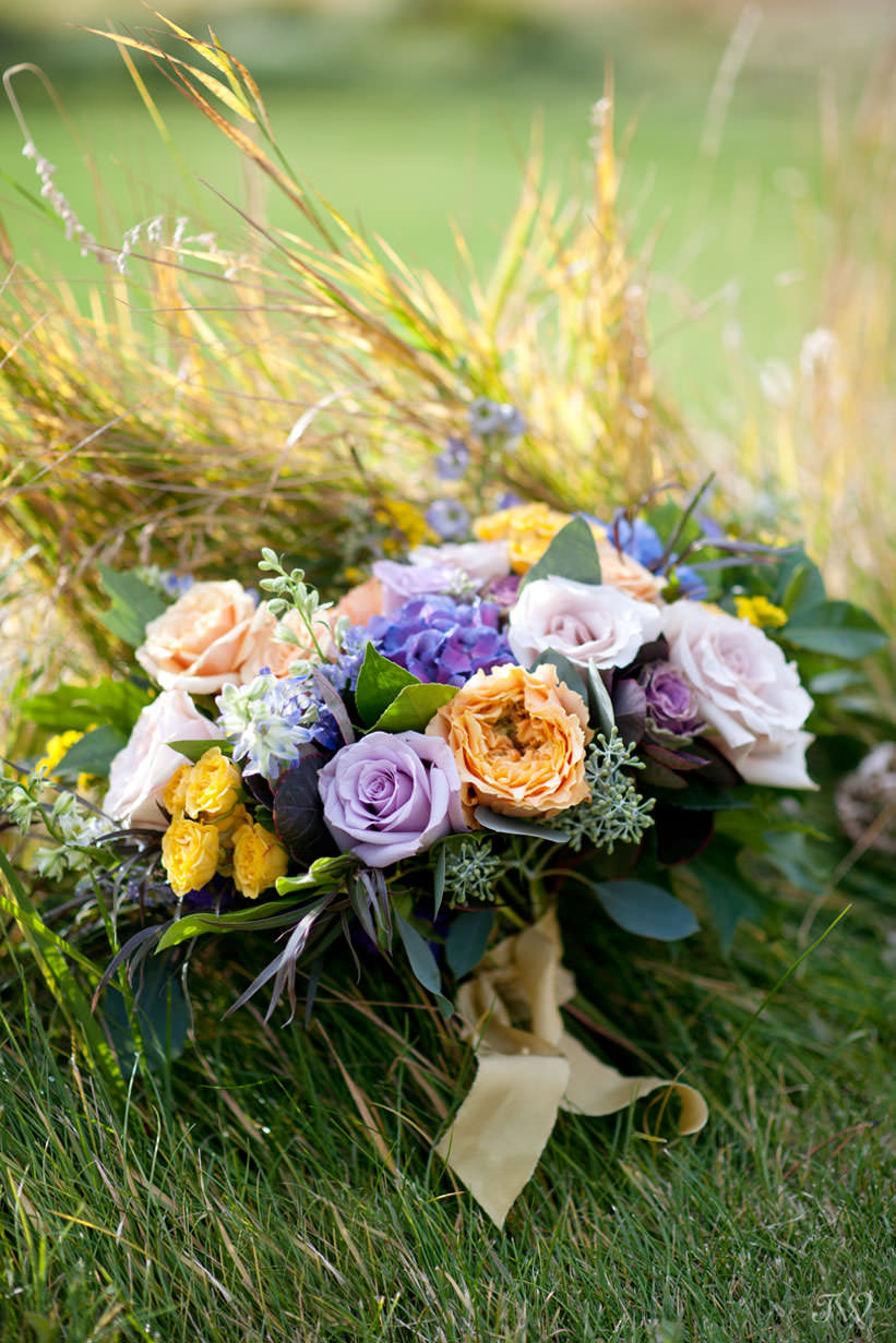 Ultra Violet blooms contrasted with mustard yellow in bridal bouquets captured by Tara Whittaker Photography