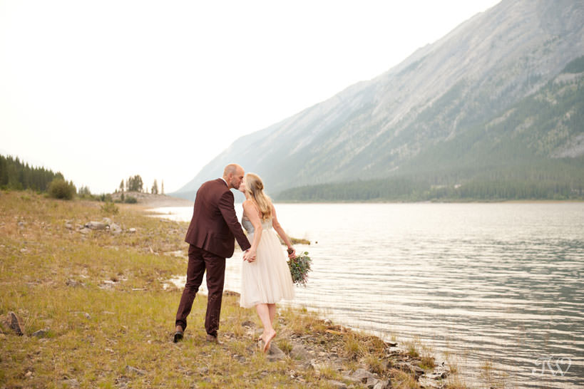 Caitie & Mark share a kiss at their Spray Lakes engagement session captured by Tara Whittaker Photography