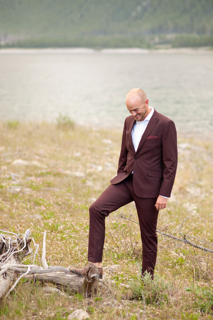 Groom on the shores of Spray Lakes captured by Tara Whittaker Photography