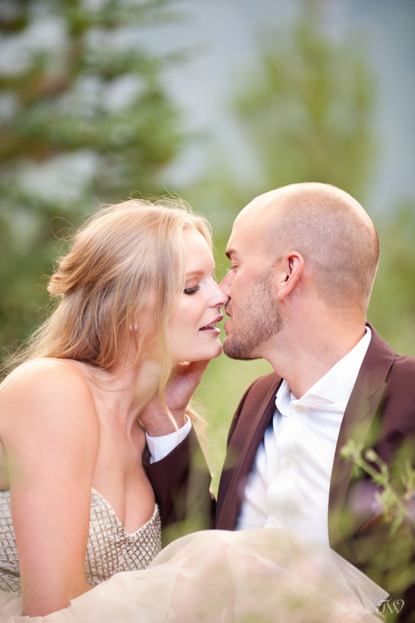 A kiss during a Spray Lakes engagement session captured by Tara Whittaker Photography