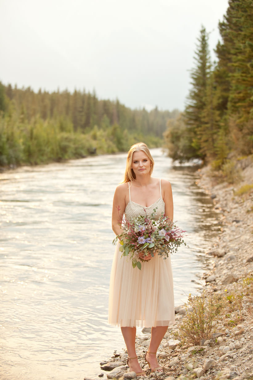 Bride with her bouquet during Spray Lakes engagement session captured by Tara Whittaker Photography