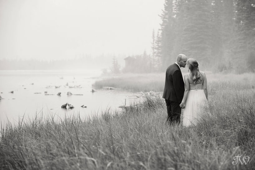 Kiss during a Spray Lakes engagement session captured by Tara Whittaker Photography