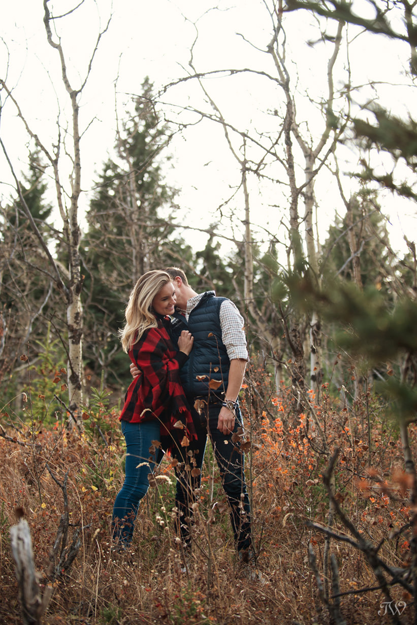 Sweet moment during Big Hill Springs engagement session captured by Tara Whittaker Photography